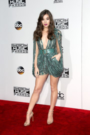 Hailee Steinfeld kept the shimmer going with a pair of gold ankle-strap sandals by Stuart Weitzman.