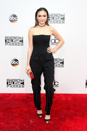 Daya opted for a strapless black jumpsuit with military pockets when she attended the 2016 AMAs.