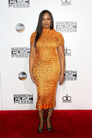 Garcelle Beauvais showed off her curvy figure in a body-con orange leopard-print dress at the 2016 AMAs.