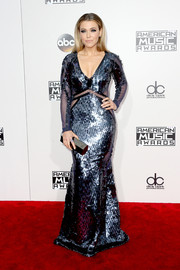 Rachel Platten finished off her look with a geometric hard-case clutch by Lee Savage.