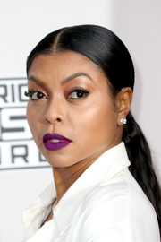 Taraji P. Henson swiped on some purple lipstick for a striking beauty look.