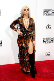Bebe Rexha flaunted her cleavage and thigh in a vintage Yves Saint Laurent tiger-print wrap dress at the 2016 AMAs.