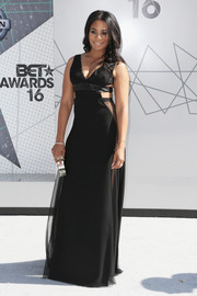 Regina Hall looked majorly sultry at the 2016 BET Awards in a deep-V black gown with sheer panels and side cutouts.