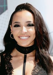 Tinashe wore her hair loose with a deep side part and billowy waves during the 2016 BET Awards.