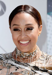 Tia Mowry went traditional with this center-parted ponytail for her 2016 BET Awards look.