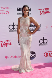 Kelly Rowland attended the Billboard Music Awards looking divine in a beaded illusion gown by Labourjoisie.