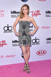 Rebecca Romijn looked fierce in a strapless silver mesh dress with a black underlay at the Billboard Music Awards.