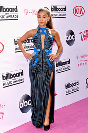 Ariana Grande looked exuberant at the Billboard Music Awards in an Atelier Versace doodle-print cutout gown with a high side slit.