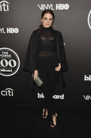 Jojo polished off her all-black look with frayed T-strap sandals.