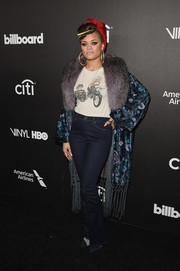High-waisted jeans completed Andra Day's eclectic getup.
