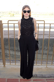 Holland Roden kept it relaxed yet stylish in a sleeveless black jumpsuit with an eyelet bodice at the 2016 Breeders' Cup.
