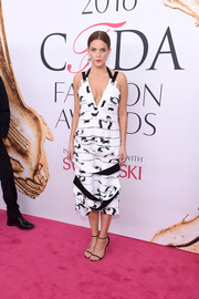 Riley Keough completed her look with barely-there black sandals.