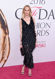 Lauren Santo Domingo looked flamboyant in a sleeveless black feather gown by Proenza Schouler at the 2016 CFDA Fashion Awards.