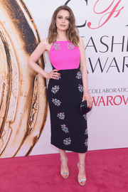 Gillian Jacobs chose elegant silver ankle-strap heels to finish off her look.