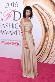 Joan Smalls looked bold and chic in a nude off-the-shoulder cutout gown by Givenchy at the 2016 CFDA Fashion Awards.