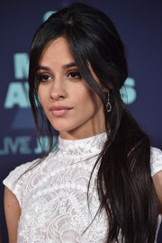 Camila Cabello polished off her look with a pair of dangling diamond earrings.