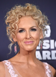 Kimberly Schlapman wore her signature curls pinned up in a messy-glam style during the 2016 CMT Music Awards.