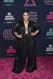 Elle King attended the 2016 CMT Music Awards looking fierce in a plunging black jumpsuit.