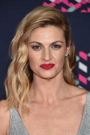 Erin Andrews looked super glam with her piecey, half-pinned waves at the 2016 CMT Music Awards.