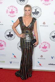 Carmen Electra cut a curvy silhouette in this striped sequin gown at the 2016 Carousel of Hope Ball.