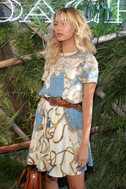 Hailey Baldwin paired her dress with a studded brown leather belt when she attended the 2016 Coach and Friends of the High Line Summer Party.