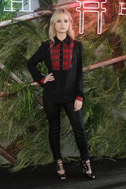 Lottie Moss teamed her blouse with black leather skinnies.