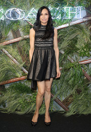 Famke Janssen looked flirty in a black and nude baby doll dress at the Coach and Friends of the High Line Summer Party.
