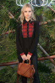 Lottie Moss arrived for the Coach and Friends of the High Line Summer Party carrying a classic fringed leather bag.