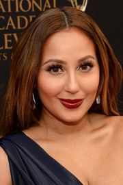 Adrienne Bailon styled her locks into a loose center-parted 'do for the 2016 Daytime Emmy Awards.