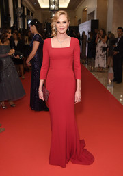 Melanie Griffith looked simply divine in a red square-neck gown by Dolce & Gabbana at the Global Gift Gala during the Dubai International Film Festival.