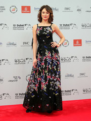 Olga Kurylenko amped up the girly charm in a floral-embroidered, spaghetti-strap gown at the 2016 Dubai International Film Festival.