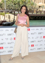 Andie MacDowell kept it simple yet sweet in a sleeveless pink satin top during day 6 of the Dubai International Film Festival.