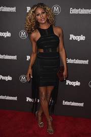 Laverne Cox looked foxy in a form-fitting black RVN cutout dress with silver trim and a fringed skirt at the Entertainment Weekly and People New York Upfronts.