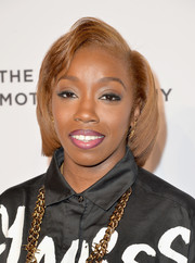 Estelle wore her hair with a deep side part and a slightly wavy top for the Essence Black Women in Music event.