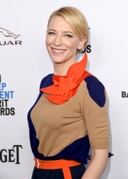 Cate Blanchett wore a classic bun with a side-swept part to show off her natural makeup.