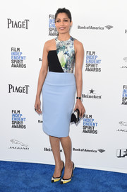 Freida Pinto kept the contemporary vibe going with a pair of geometric pumps by Ferragamo.