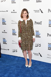 Emilia Clarke went the conservative route in a long sleeve floral blouse by Michael Kors when she attended the Film Independent Spirit Awards.