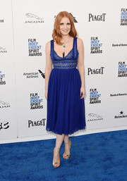 Jessica Chastain injected some shine with a pair of gold ankle-strap heels by Roger Vivier.