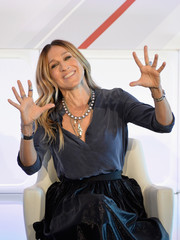 Sarah Jessica Parker teamed a gray button-down with a shimmering skirt for the Forbes Women's Summit.