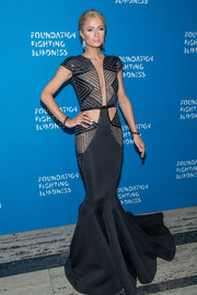 Paris Hilton wowed in a black Charbel Zoe Couture mermaid gown with a beaded, sheer bodice at the Foundation Fighting Blindness World Gala.