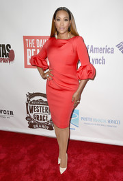 Vivica A. Fox finished off her outfit with a pair of hand-print pumps by Christian Louboutin.