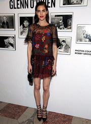 Hilary Rhoda looked whimsical in a sheer, floral-embroidered dress with a striped underlay at the Free Arts NYC benefit.