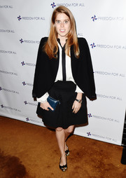 Princess Beatrice completed her office-chic outfit with a black tweed mini skirt.