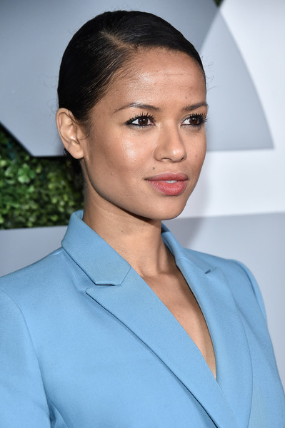 More Pics of Gugu Mbatha-Raw Classic Bun (1 of 3) - Updos Lookbook - StyleBistro [hair,face,eyebrow,hairstyle,lip,chin,beauty,forehead,fashion,white-collar worker,arrivals,gugu mbatha-raw,california,los angeles,chateau marmont,gq men of the year party]