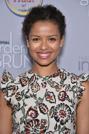 Gugu Mbatha-Raw styled her hair into a simple curly updo for the 2016 Garden Brunch.