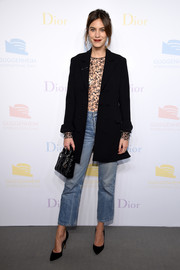 Alexa Chung accessorized with a classic quilted purse, also by Dior.