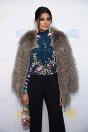 Rachel Roy teamed a taupe fur coat with a print blouse and black pants for the 2016 Guggenheim International pre-party.