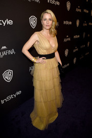 Gillian Anderson was sexy-glam at the InStyle and Warner Bros. Golden Globes post-party in a pale-yellow Burberry gown with a plunging neckline and a tiered skirt.