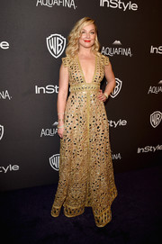 Elisabeth Rohm went for exotic elegance in a mirror-embellished gold gown by Jani Khosla at the InStyle and Warner Bros. Golden Globes post-party.