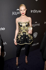 Kate Bosworth paired her blingy top with simple black capri pants, also by Dolce & Gabbana.